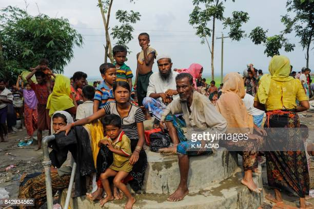 TOPSHOT Rohingya refugees from Myanmar's Rakhine state look on after arriving near the Khanchon border crossing near the Bangladeshi town of Teknaf...