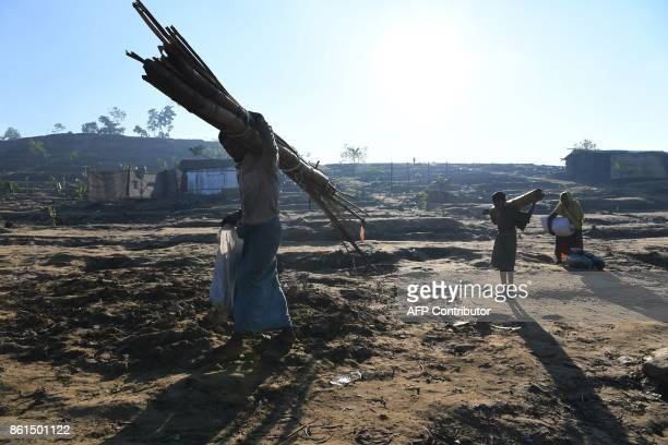 Rohingya refugees leave a roadside camp to move to Ghumdhum camp as ordered by the Bangladeshi administration at the Thaingkhali refugee camp in the...