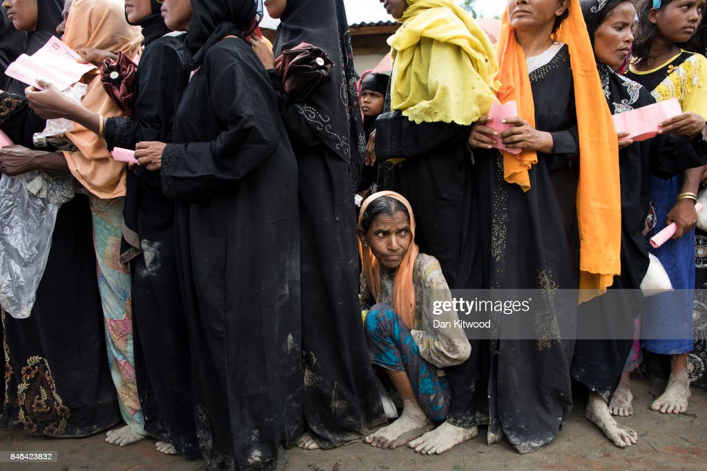 Rohingya refugees line up for food assistance on September 13, 2017 in Kutupalong, Bangladesh. Recent reports have suggested that nearly 400,000 Rohingya have now fled Myanmar after violence erupted in Rakhine state. Myanmar's leader Aung San Suu Kyi has reportedly cancelled her plans to attend the UN General Assembly after strong international criticism for not speaking out about the violence against the Rohingya Muslim population.