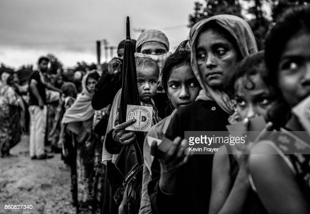 COX'S BAZAR BANGLADESH SEPTEMBER 18 Rohingya refugees line up to get food aid from a local NGO after arriving from Myanmar at the Balukali refugee...