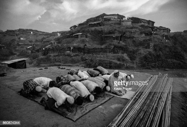 COX'S BAZAR BANGLADESH SEPTEMBER 25 Rohingya refugees pray at the site where they are building a new mosque at the sprawling Balukali refugee camp on...