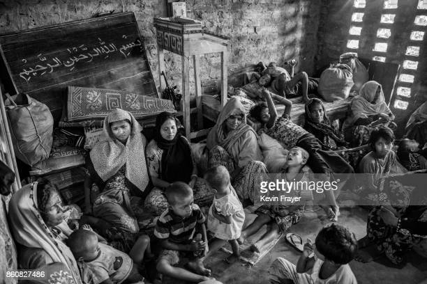 COX'S BAZAR BANGLADESH SEPTEMBER 22 Rohingya refugees rest in an Islamic school or madrassa after arriving by boat on the Bangladesh side of the Naf...