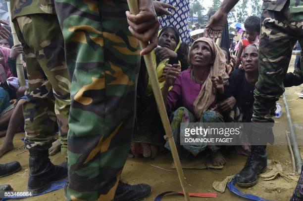 TOPSHOT Rohingya refugees wait for food distribution organised by the Bangladesh army at the refugee camp of Balukhali near Gumdhum on September 25...