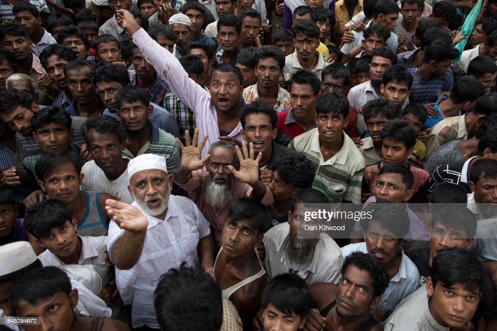 Rohingya refugees wait for sacks of rice to be distributed on September 10, 2017 in Whaikhyang, Bangladesh. Recent reports have suggested that around 290,000 Rohingya have now fled Myanmar after violence erupted in Rakhine state. The 'Muslim insurgents of the Arakan Rohingya Salvation Army' have issued statement that indicates that they are to observe a cease fire, and have asked the Myanmar government to reciprocate.