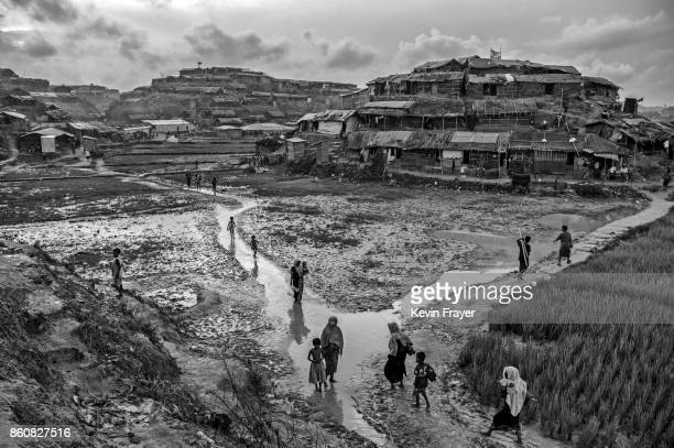 COX'S BAZAR BANGLADESH OCTOBER 02 Rohingya refugees walk in the sprawling Balukali refugee camp on October 2 2017 in Cox's Bazar Bangladesh More than...