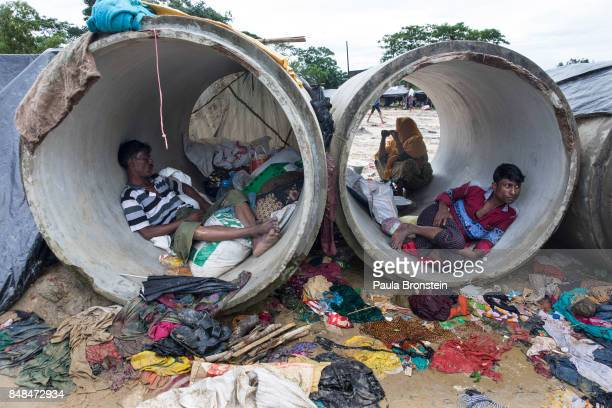 KUTUPALONG BANGLADESH SEPTEMBER 17 Rohingya rest inside a cement cylinder while a lack of shelters continues to be a massive problem September 17...