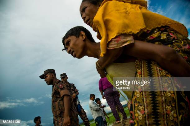 A Rohingya son taking her mother to the Hospital at Palongkhali in Cox's Bazar Bangladesh on October 17 2017 15000 fled from Buthidaung of Myanmar...