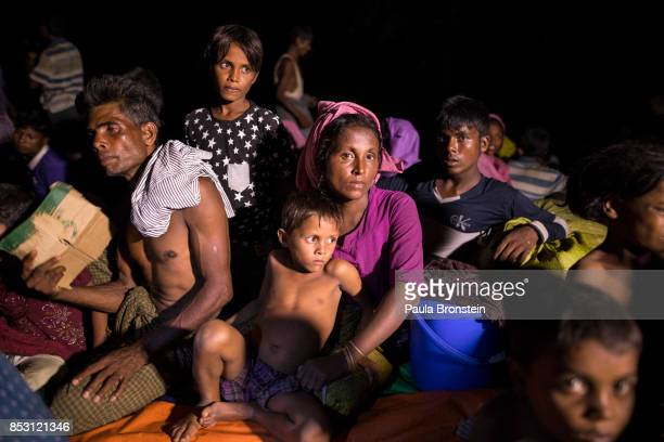 Rohingya who just arrived gather together sleeping without any shelter after arriving by foot from Myanmar September 24 2017 in Thainkhali Cox's...