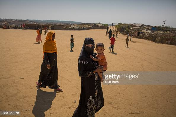 Rohingya woman carries her child in Kutupalong Refugee Camp Cox's Bazar Bangladesh on February 13 2017 After attacks by Rohingya militants on border...