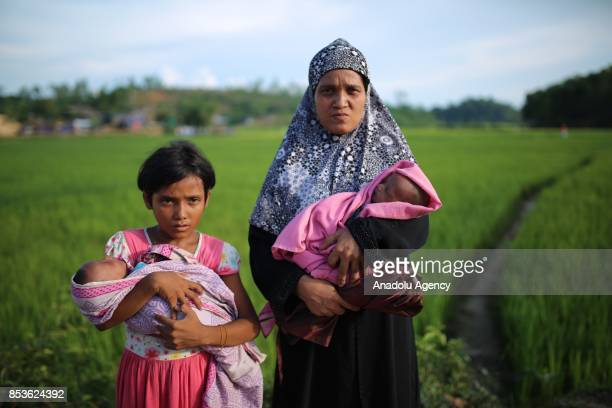 Rohingya woman fled from oppression within ongoing military operations in Myanmars Rakhine state pose for a photo along with a little girl and two...