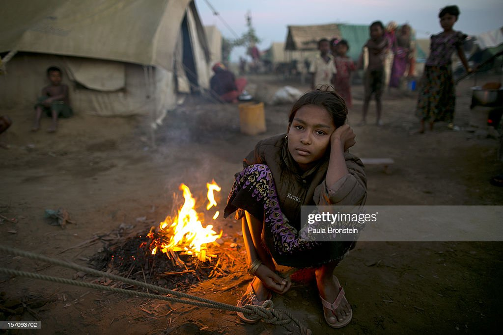 A Rohingya woman sits by a fire at a crowded internally displaced persons (IDP) camp November 23, 2012 on the outskirts of Sittwe, Myanmar. An estimated 111,000 people were displaced by sectarian violence in June and October, effecting mostly the ethnic Rohingya people, who are now living in crowded IDP camps racially segregated from the Rakhine Buddhists in order to maintain stability. Around 89 lives were lost during a week of violence in October, the worst in decades. As of 2012, 800,000 Rohingya live in Myanmar. According to the UN, they are one of the most persecuted minorities in the world.