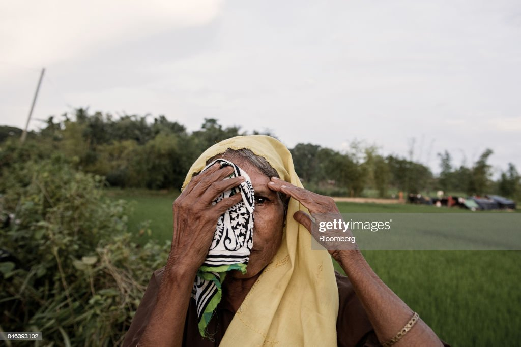 A Rohingya woman uses a piece of cloth to conceal an eye injury at a newly set-up refugee camp at Balukhali in Cox's Bazar, Bangladesh, on Tuesday, Sept. 12, 2017. Myanmar's leader Aung San Suu Kyi is under attack over her response to a fresh round of violence that has seen more than 145,000 minority Rohingya Muslims flee into neighboring Bangladesh since last month. Photographer: Ismail Ferdous/Bloomberg via Getty Images