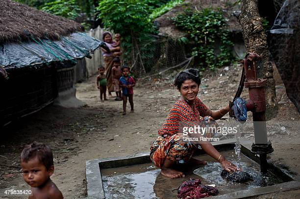 Rohingya woman washes clothes in an informal settlement July 4 2015 in Shamlapur Bangladesh In the past months thousands of Rohingya have landed on...