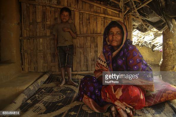 A Rohingya women and her child sit at thier makeshift refugees camp in Kutupalong Bangladesh on February 15 2017 Almost 60000 thousand refugees from...