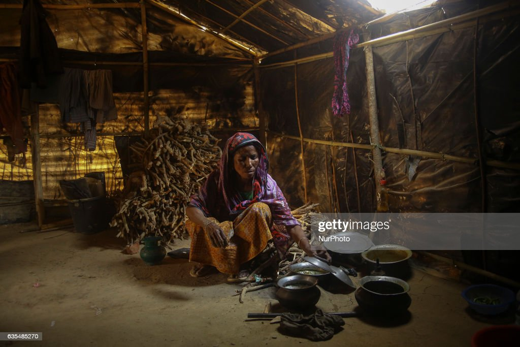 A Rohingya women cook a rice inside the makeshift refugee camp in Balu Khali, Bangladesh on February 15, 2017. Almost 2000 thousand Rohingya family arrived at Balu Kali camp a month ago living in makeshift camp after conflict in Rakhine state started October last year flee to Bangladesh. More than 31 Non-goverment organisations (NGO) include Mapim and Kelab Putra 1 Malaysia from Malaysia, Indonesia, China, France, Germany, and United States joint forces bringing almost 2300 tonne of humanitarian goods include medicine, food, cooking oil and cloth were sending to ethnic minority Rohingya in Yangon and Teknaf.