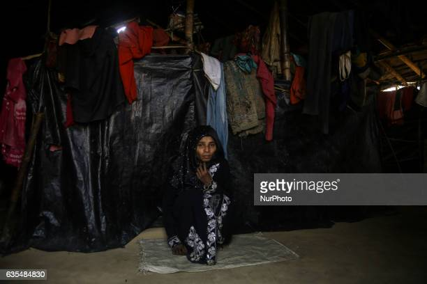 A Rohingya women is seen sit inside her makeshift refugees camp in Kutupalong Bangladesh on February 15 2017 Almost 60000 thousand refugees from...