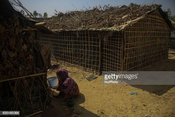 A Rohingya women repair her makeshift house at the Balu Khali Rohingya refugee camp on February 15 2017 Almost 2000 thousand Rohingya family arrived...