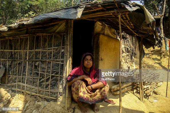 A Rohingya women sit oustide her makeshift refugees camp in Kutupalong Bangladesh on February 15 2017 Almost 60000 thousand refugees from Maungdaw...