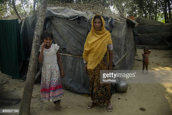 A Rohingya women stand in front of her house make from turpaulin sheet inside the makeshift Leda Rohingya refugee camp on February 15 2017 in...