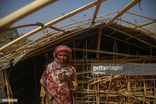 A Rohingya women stand in front of the makeshift Balu Khali Rohingya refugee camp on February 15 2017 in Bangladesh Almost 2000 thousand Rohingya...