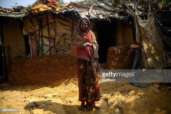 A Rohingya women stand oustide her makeshift refugees camp in Kutupalong Bangladesh on February 15 2017 Almost 60000 thousand refugees from Maungdaw...