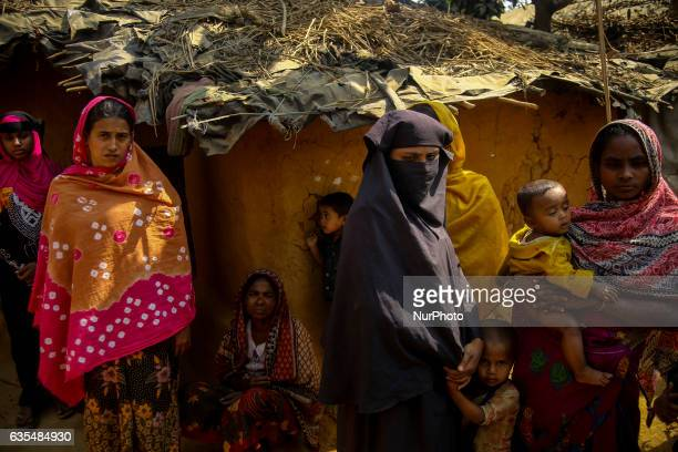 A Rohingya women stand oustide their makeshift refugees camp in Kutupalong Bangladesh on February 15 2017 Almost 60000 thousand refugees from...