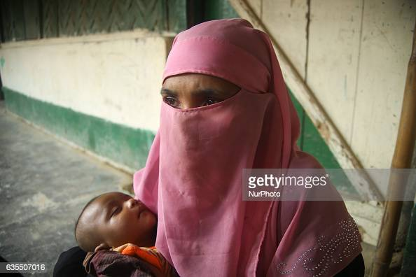 A Rohingya women wait her humanitarian aid at the distributions centre i in makeshift Leda Rohingya refugee camp on February 15 2017 in Bangladesh...