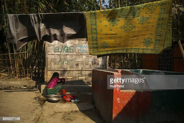 A Rohingya women washing her utensil inside the makeshift Leda Rohingya refugee camp on February 15 2017 in Bangladesh Thousands of Rohingya living...