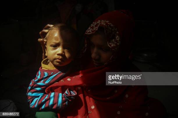 A Rohingya women with her child inside the makeshift refugee camp in Balu Khali Bangladesh on February 15 2017 Almost 2000 thousand Rohingya family...