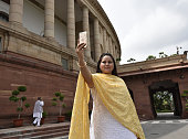 Rohini Yadav daughter of Lalu Prasad Yadav taking selfie at Parliament House on the opening day of the Monsoon Session on July 18 2016 in New Delhi...