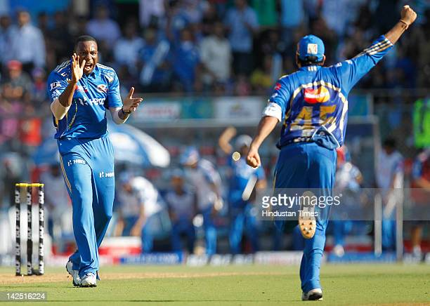 Rohit Sharma and Kieron Pollard of the Mumbai Indians celebrates capturing the wicket of Callum Ferguson of the Pune Warriors during the IPL 5 match...