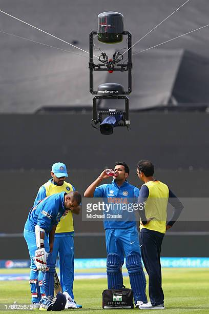 Rohit Sharma and Shikhar Dhawan of India are watched over by a spidercam during a drinks breakduring the Group B ICC Champions Trophy match between...