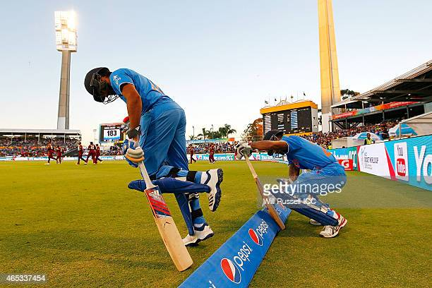 Rohit Sharma and Shikhar Dhawan of India enter the field to bat during the 2015 ICC Cricket World Cup match between India and the West Indies at WACA...