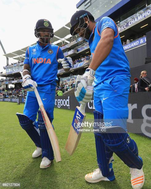 Rohit Sharma and Shikhar Dhawan of India go out to bat during the ICC CHampions Trophy match between India and Pakistan at Edgbaston on June 4 2017...