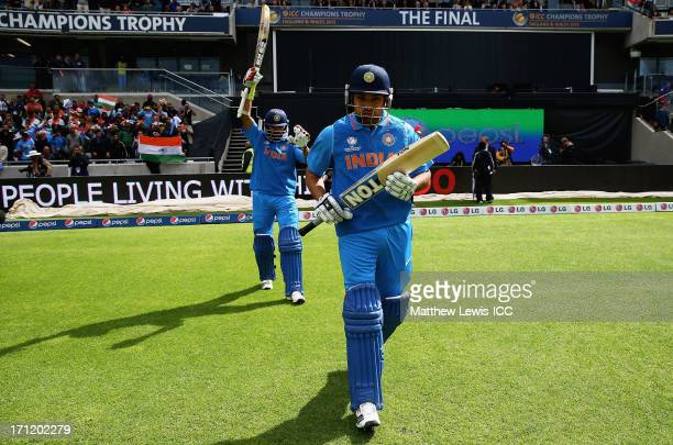 Rohit Sharma and Shikhar Dhawan of India walk out to face England during the ICC Champions Trophy Final between England and India at Edgbaston on...