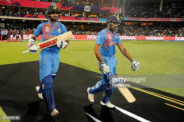 Rohit Sharma and Shikhar Dhawan of India walk to bat during the ICC World Twenty20 India 2016 match between India and Bangladesh at the Chinnaswamy...