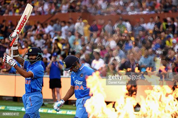 Rohit Sharma of India and Shikhar Dhawan of India walk out onto the field to bat prior to game one of the Twenty20 International match between...