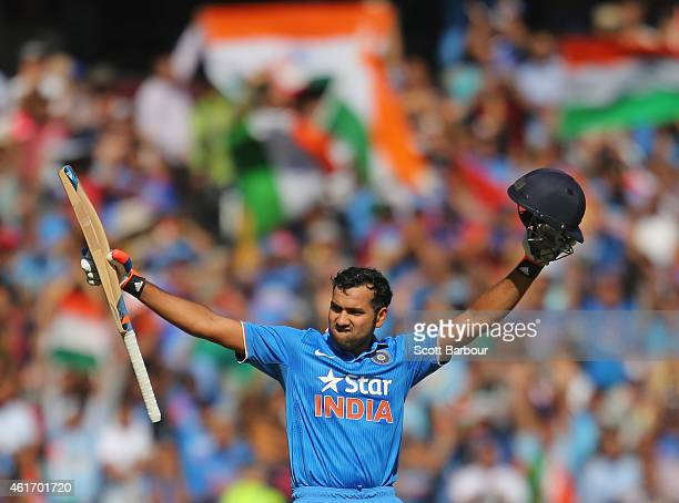 Rohit Sharma of India celebrates as he reaches his century during the One Day International match between Australia and India at the Melbourne...