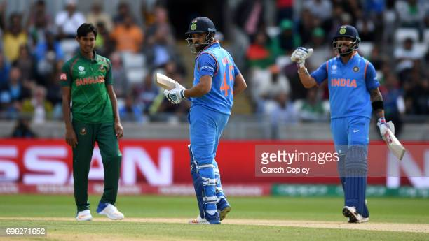 Rohit Sharma of India celebrates with Virat Kohli after reaching his century during the ICC Champions Trophy Semi Final between Bangladesh and India...