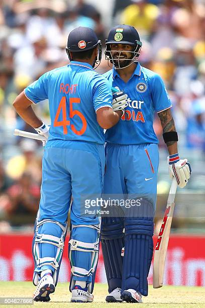 Rohit Sharma of India congratulates Virat Kholi after reaching his half century during the Victoria Bitter One Day International Series match between...