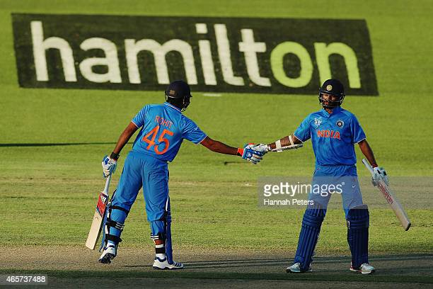 Rohit Sharma of India conratulates Shikhar Dhawan of India after their 100 run partnership during the 2015 ICC Cricket World Cup match between...