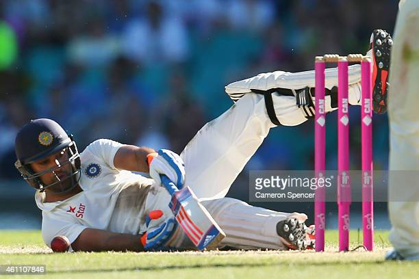 Rohit Sharma of India falls over batting during day two of the Fourth Test match between Australia and India at Sydney Cricket Ground on January 7...