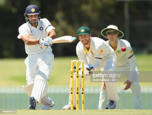 Rohit Sharma of India hits a boundary as wicketkeeper Seb Gotch of the Cricket Australia XI looks on during the international tour match between the...
