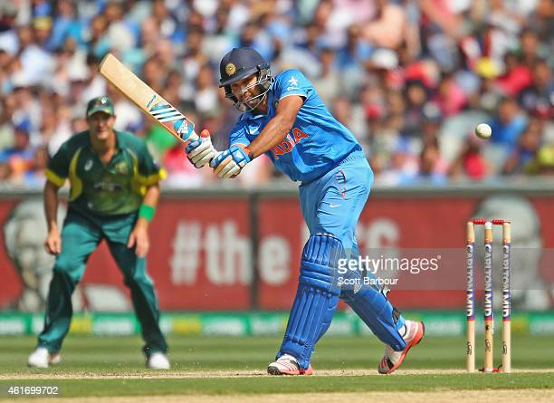 Rohit Sharma of India hits a boundary during the One Day International match between Australia and India at the Melbourne Cricket Ground on January...