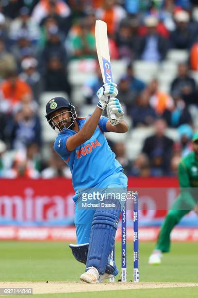 Rohit Sharma of India hits a straight four during the ICC Champions Trophy match between India and Pakistan at Edgbaston on June 4 2017 in Birmingham...