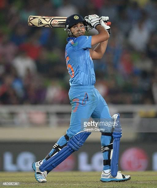 Rohit Sharma of India hits out for six runs during the ICC World Twenty20 Bangladesh 2014 semi final between India and South Africa at ShereBangla...