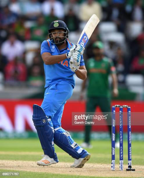 Rohit Sharma of India hits out for six runs to bring up his century during the ICC Champions Trophy Semi Final between Bangladesh and India at...