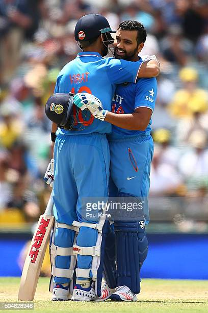 Rohit Sharma of India is congratulated by Virat Kholi after scoring his century during the Victoria Bitter One Day International Series match between...