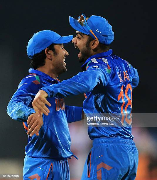 Rohit Sharma of India is congratulated by Virat Kohli after catching David Warner of Australia during the ICC World Twenty20 Bangladesh 2014 match...