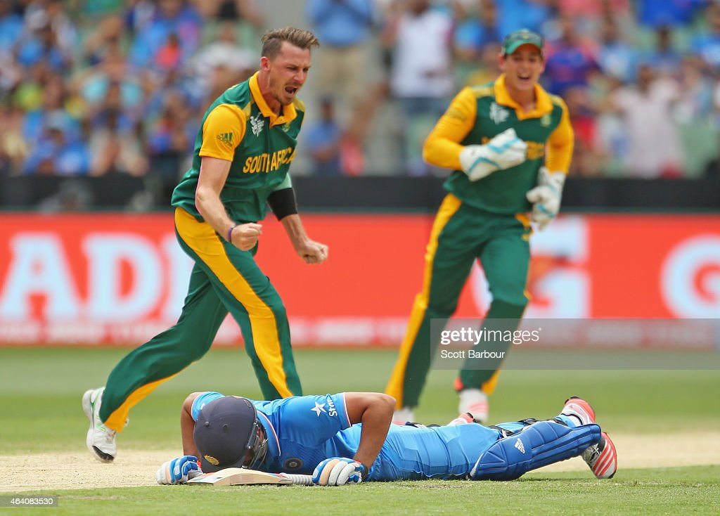 <a gi-track='captionPersonalityLinkClicked' href=/galleries/search?phrase=Rohit+Sharma&family=editorial&specificpeople=815520 ng-click='$event.stopPropagation()'>Rohit Sharma</a> of India lies on the ground dejected after he was run out as bowler <a gi-track='captionPersonalityLinkClicked' href=/galleries/search?phrase=Dale+Steyn&family=editorial&specificpeople=649553 ng-click='$event.stopPropagation()'>Dale Steyn</a> of South Africa celebrates during the 2015 ICC Cricket World Cup match between South Africa and India at Melbourne Cricket Ground on February 22, 2015 in Melbourne, Australia.